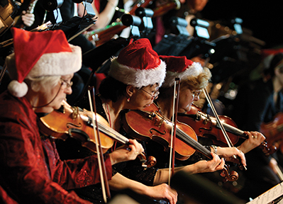 The 3 violinists are Pat Blackie, Linda Nystrom and Janina Romiszewski